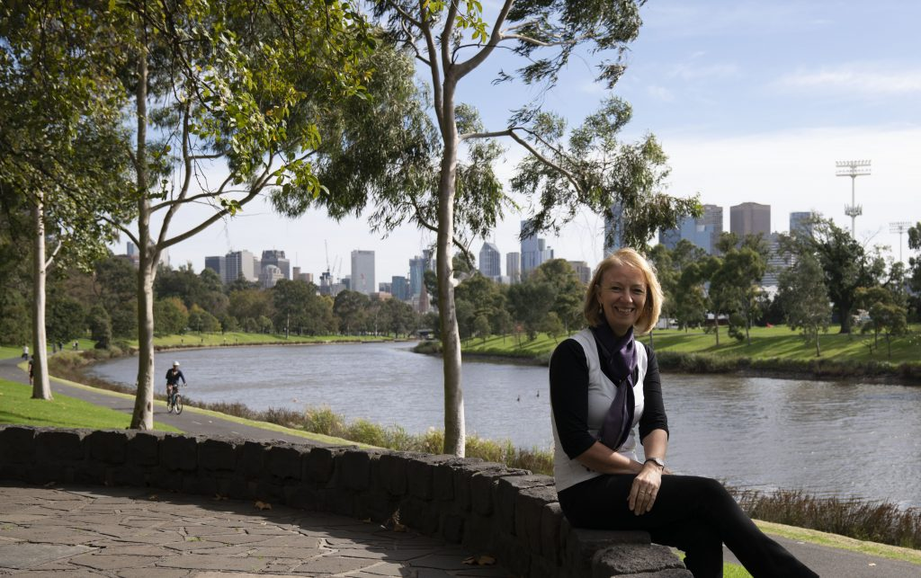 Catriona Anderson sitting near river